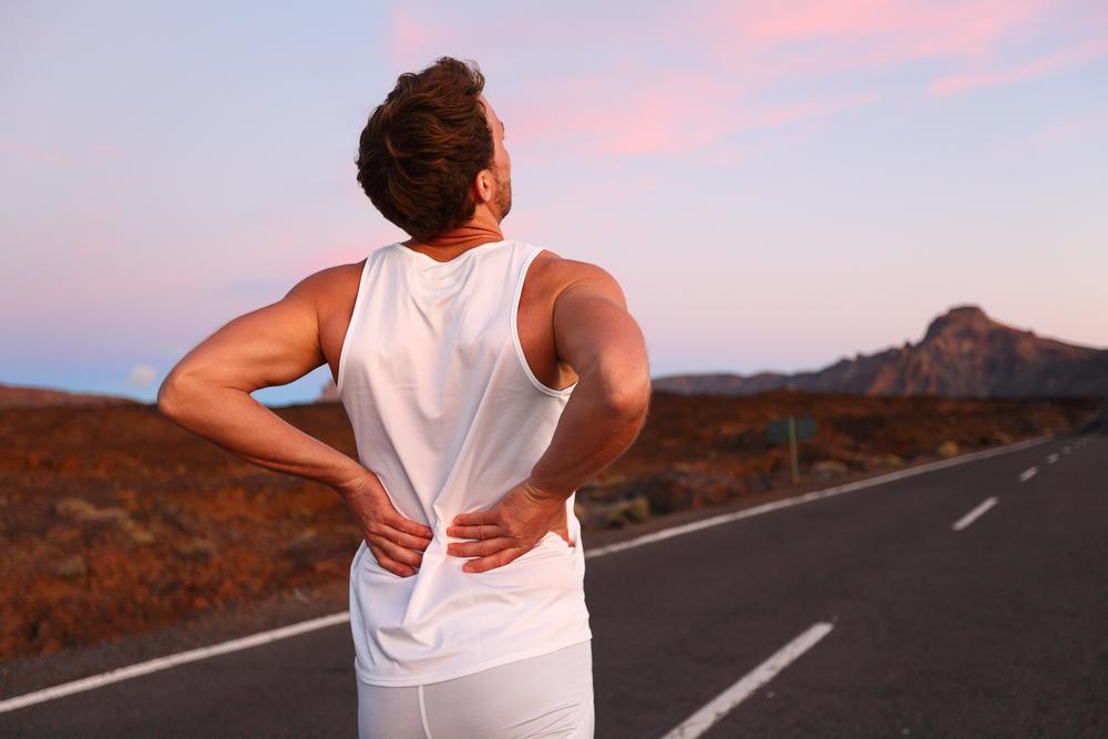 Почему болит спина после тренировки